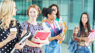 University students walking with booksの写真素材 [FYI02159404]