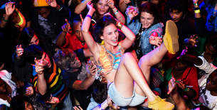Enthusiastic woman crowd surfing at music festivalの写真素材 [FYI02159519]