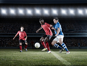 Soccer players with ball on fieldの写真素材 [FYI02159808]