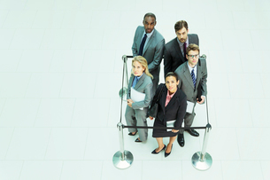 Business people standing in roped-off squareの写真素材 [FYI02159999]