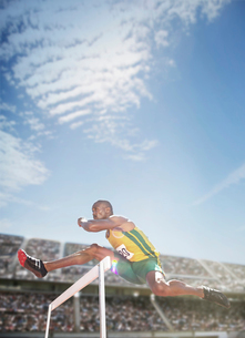 Track and field athlete jumping hurdleの写真素材 [FYI02161117]