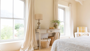 Curtain and vanity table in rustic bedroomの写真素材 [FYI02162280]