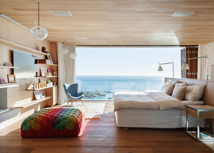 Sunny bedroom with ocean viewの写真素材 [FYI02162656]
