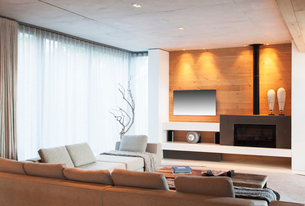 Sofas, curtains and fireplace in modern living roomの写真素材 [FYI02162754]
