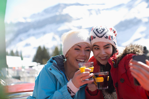 Friends in warm clothing taking selfie outdoorsの写真素材 [FYI02165032]
