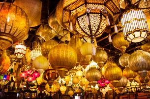 Low angle view of various illuminated lamps in marketの写真素材 [FYI02165571]