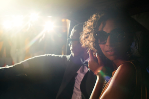 Portrait of celebrity couple in limousine arriving at eventの写真素材 [FYI02166852]