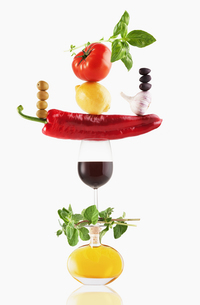 Fruit, vegetables, olive oil and wine balancingの写真素材 [FYI02167031]