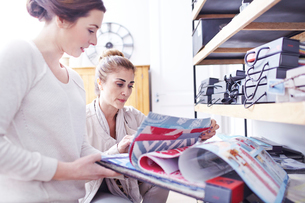 Interior designers browsing fabric swatches in officeの写真素材 [FYI02167095]