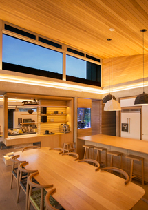 Illuminated wood ceiling over kitchen and dining tableの写真素材 [FYI02167330]