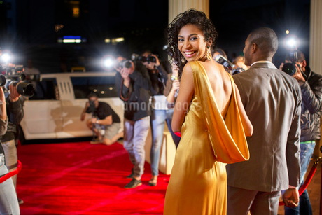 Portrait of smiling celebrity leaving red carpet eventの写真素材 [FYI02167337]