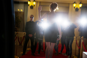 Silhouette of celebrity in black dress arriving at event and waving to paparazzi photographersの写真素材 [FYI02167352]