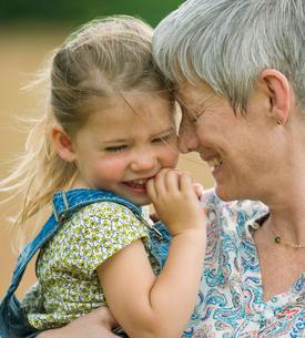 Close up grandmother and granddaughter huggingの写真素材 [FYI02167928]