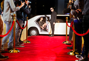 Bodyguard opening limousine for celebrity arriving at red carpet eventの写真素材 [FYI02168372]