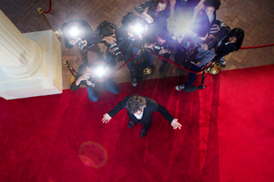 Paparazzi photographers photographing celebrity at red carpet eventの写真素材 [FYI02168451]