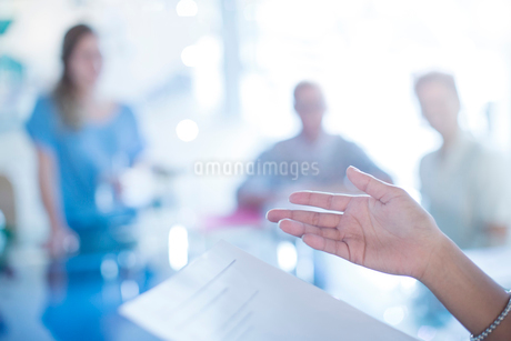 Close up of businesswoman's hand gesturing to paperwork in meetingの写真素材 [FYI02168621]