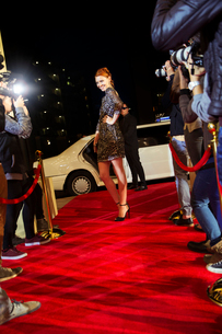 Confident celebrity arriving and posing for paparazzi photographers at red carpet eventの写真素材 [FYI02168633]