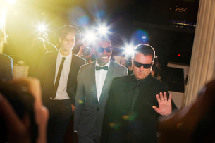 Bodyguard escorting celebrities arriving at event and being photographed by paparazziの写真素材 [FYI02168660]