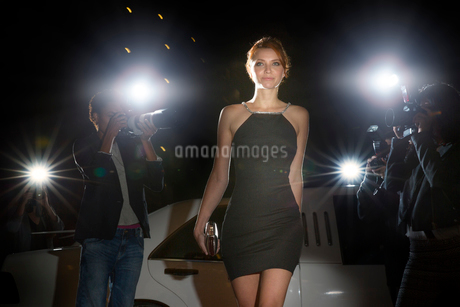 Celebrity in black dress arriving at event and being photographed by paparazziの写真素材 [FYI02168704]
