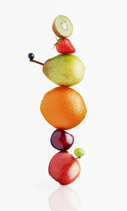 Stacked fruit on white backgroundの写真素材 [FYI02168900]