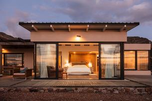 Illuminated home showcase bedroom with open patio doorsの写真素材 [FYI02170984]