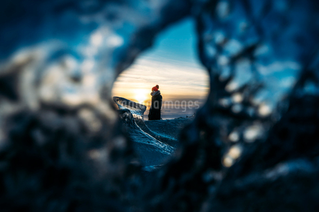 View of woman through hole in ice, Icelandの写真素材 [FYI02171740]