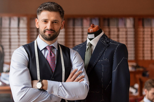 Portrait confident tailor in menswear shopの写真素材 [FYI02171851]