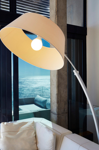 Arc sectional lamp in luxury living room with ocean viewの写真素材 [FYI02171868]