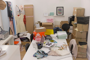 Clothing and boxes in messy fashion buyeris officeの写真素材 [FYI02173158]