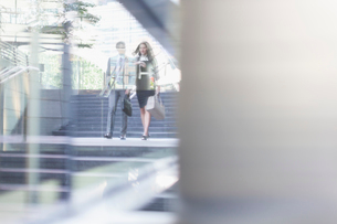Corporate businessman and businesswoman walking outdoorsの写真素材 [FYI02174547]