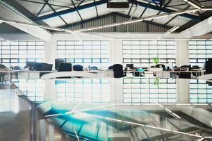 Glass table in empty open modern officeの写真素材 [FYI02174668]