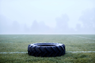 Rubber tire on foggy football fieldの写真素材 [FYI02175016]