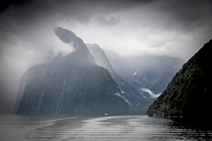 Clouds and fog surrounding cliffs, Milford Sound, South Island New Zealandの写真素材 [FYI02175254]