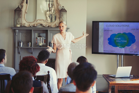 Businesswoman leading conference presentation at television screenの写真素材 [FYI02175310]