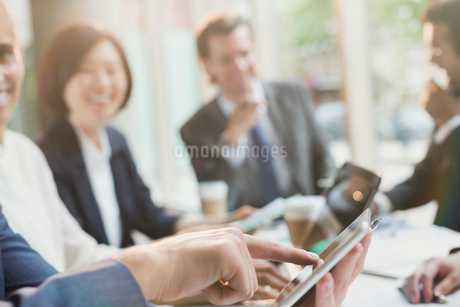 Businessman touching digital tablet in conference room meetingの写真素材 [FYI02175443]