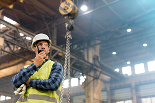 Steel worker with walkie-talkie in factoryの写真素材 [FYI02175786]