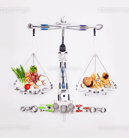 Still life concept healthy and unhealthy foods forming scaleの写真素材 [FYI02175836]