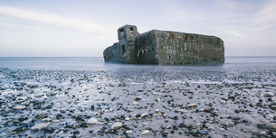 Ruins in ocean at low tide and rocks on beach, Vigsoe, Denmarkの写真素材 [FYI02177346]