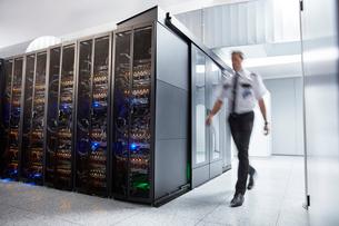 Male security guard walking in server roomの写真素材 [FYI02178344]