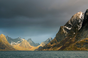 Dark clouds above rugged mountains, Reine, Lofoten, Norwayの写真素材 [FYI02179073]