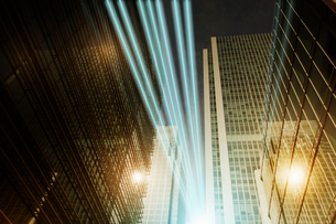 Fiber optic light trail communication technology streaming through highrise buildings, conceptの写真素材 [FYI02179107]
