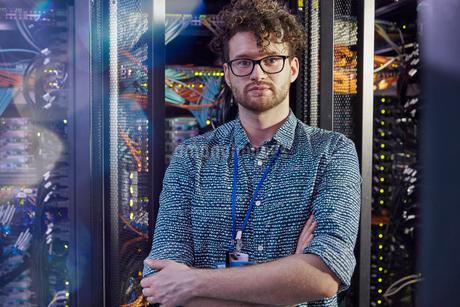 Portrait confident male IT technician in server roomの写真素材 [FYI02179321]
