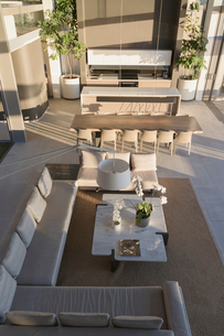 Elevated view luxury, modern home showcase interior living room and dining roomの写真素材 [FYI02179913]