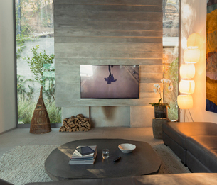 Television in modern, luxury home showcase interior living roomの写真素材 [FYI02180375]