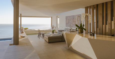 Modern, luxury home showcase living room open to ocean viewの写真素材 [FYI02181461]