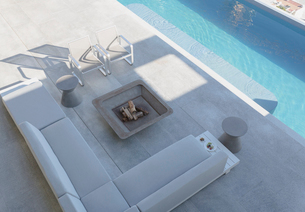Elevated view modern, luxury home showcase exterior patio with sofa, fire pit and lap poolの写真素材 [FYI02181729]