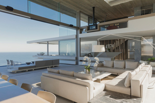 Modern, luxury home showcase interior living room with ocean viewの写真素材 [FYI02181759]