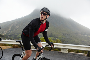 Male cyclist cycling mountain roadの写真素材 [FYI02182162]