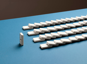One standing domino and toppled dominoes in rowsの写真素材 [FYI02182322]