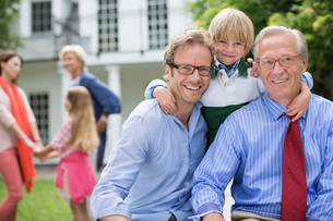 Three generations of men smiling togetherの写真素材 [FYI02184048]
